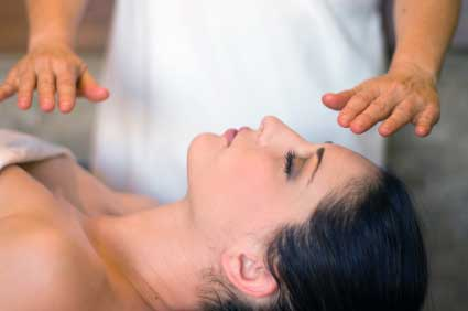 Reiki practitioner working with a client